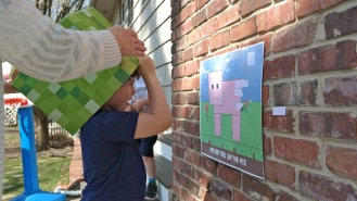 Guest playing pin the tail on the pig game